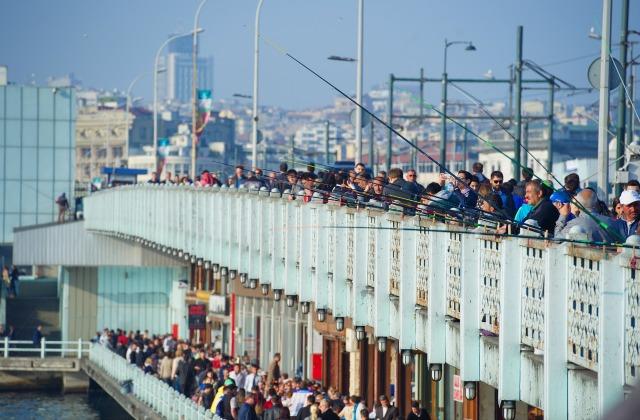 Croweded Galata Bridge between Eminonu and Karakoy in Istanbul