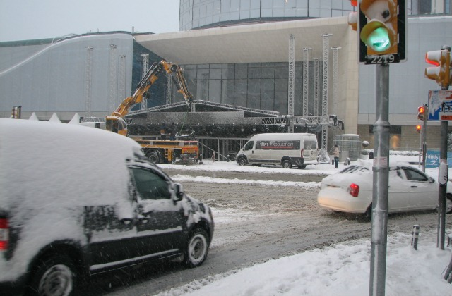 Workers putting up a stage in front of Akmerkez shopping center for a New Year show.