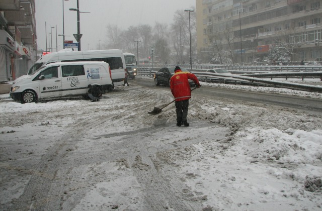 Gas station worker clearing entry to the station for cars to be able to get gas