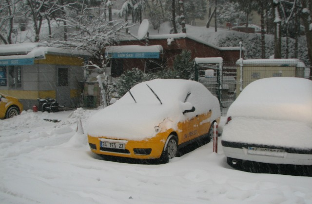 Taksi protecting windshields from frost. Snow in Istanbul.