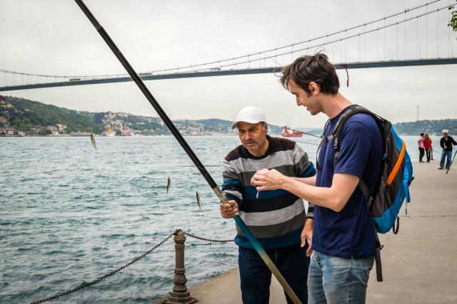 Fisher at Bosphorus Strait in Istanbul, Turkey